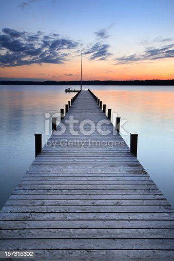 woman sitting in meditation at the end of the jetty