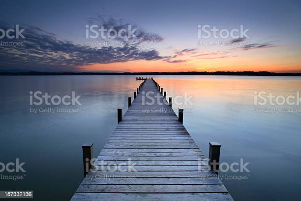 woman meditating at the end of the jetty