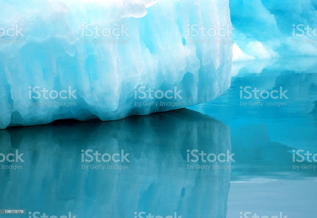 Silent reflections of an iceberg in Greenland royalty-free stock photo