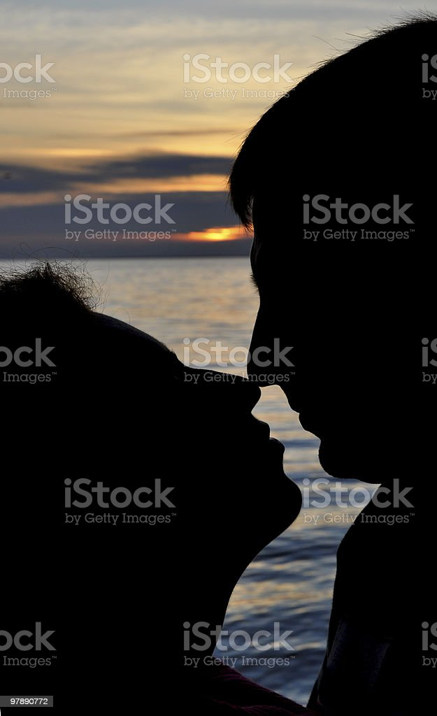 Silhoette of kissing couple royalty-free stock photo