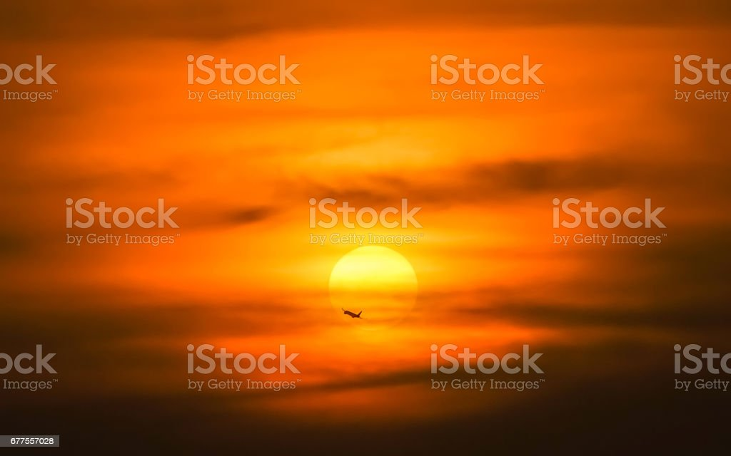silhouette Airplane in the air with sunset in background royalty-free stock photo