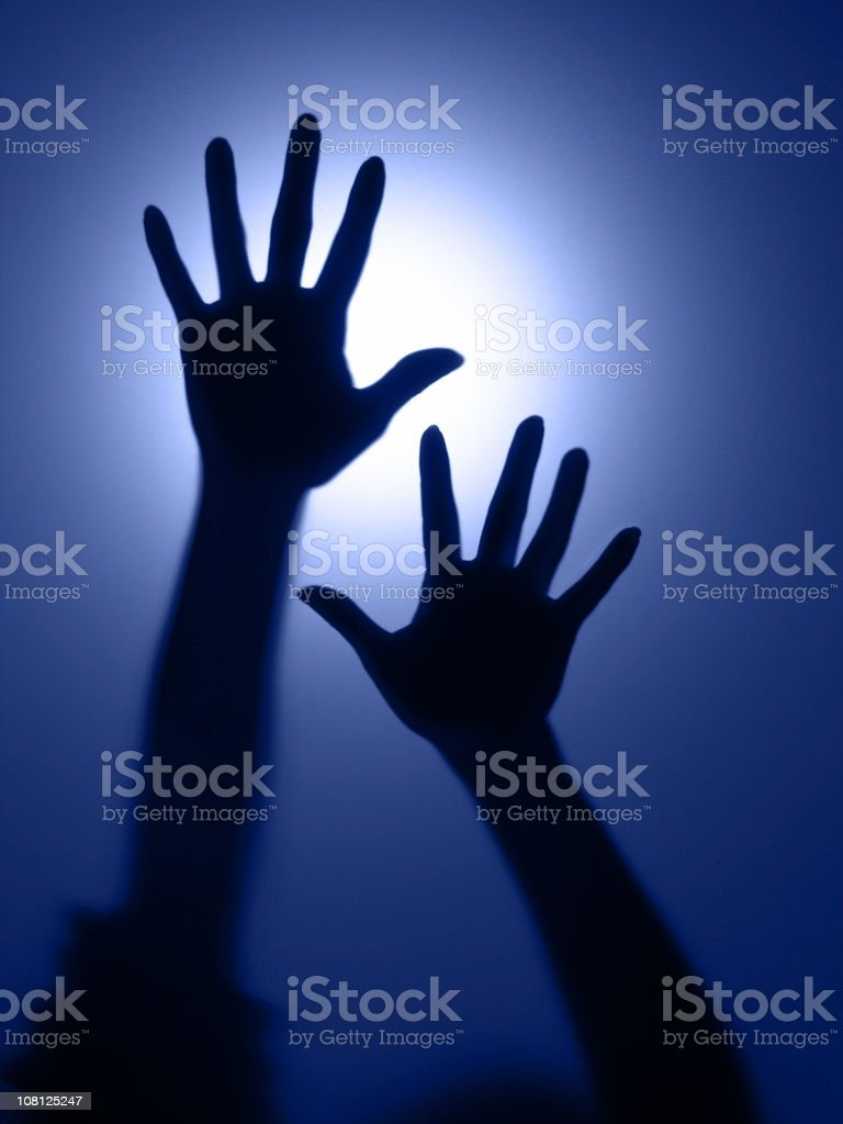 Silhouette and Shadow of Person's Hands: defocused motion stock photo