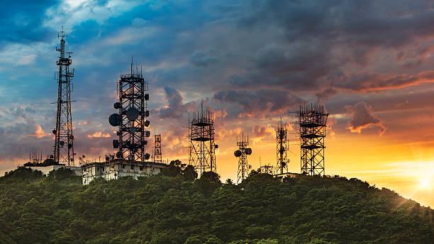 Silhouette Antenna towe with sunset background Silhouette Antenna tower and repeater of Communication and telecommunication with the mountain on the background of sunset.Hong Kong China. telecommunications equipment stock pictures, royalty-free photos & images