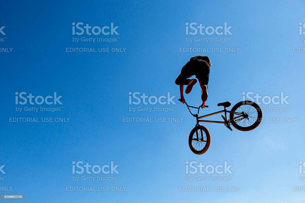 Silhouette biker blue sky stock photo
