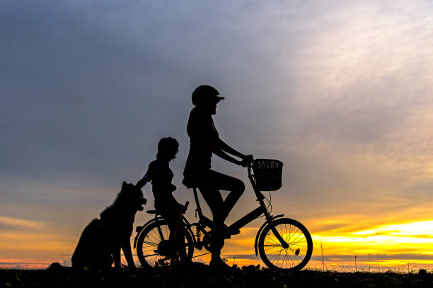Silhouette biker lovely family at sunset over the ocean mom and with picture id843103130?b=1&k=6&m=843103130&s=612x612&w=0&h=f8kzmmquh ndvcvfkpfl7rhzp50me taeg75ar6zdao=