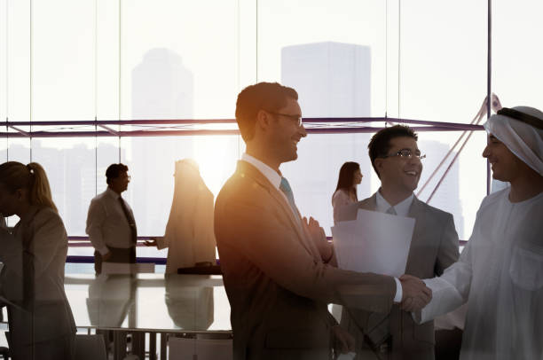 silhouette business people discussion meeting cityscape team concept - middle east stock pictures, royalty-free photos & images