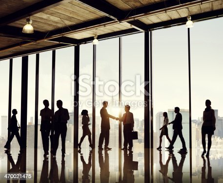 istock Silhouette businesspeople entering office building 470021475