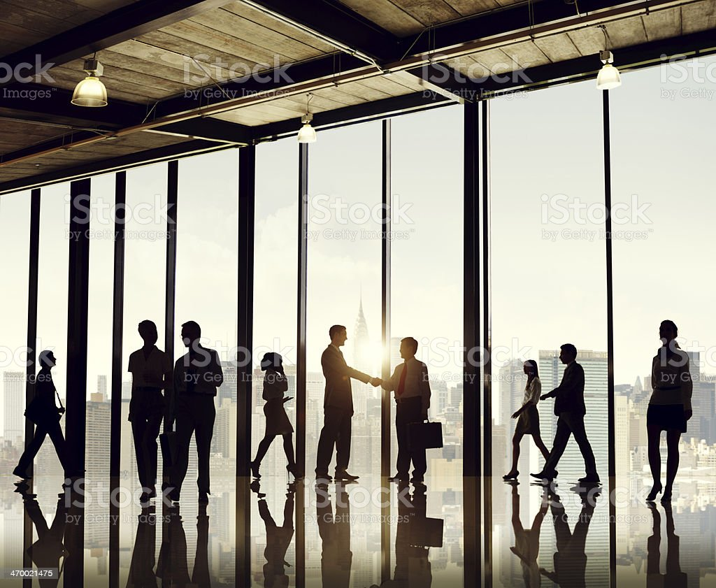 Silhouette businesspeople entering office building stock photo