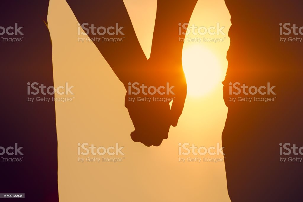 silhouette couple love holding hands together royalty free stock photo