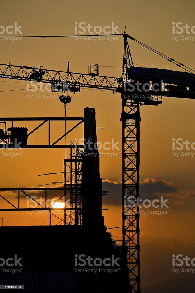 silhouette crane building and sunset time royalty-free stock photo