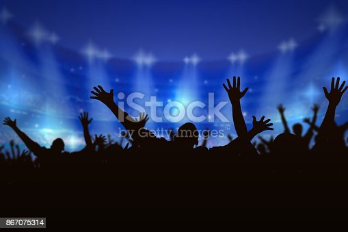 istock Silhouette Crowd people enjoying the concert, happy people jumping, a large group celebrating new year holiday, party background fun concept. 867075314