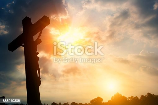 istock Silhouette Crucifixion of Jesus Christ and the sunset 888210308