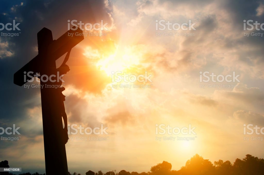 Silhouette Crucifixion of Jesus Christ and the sunset stock photo