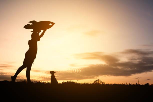Silhouette dream of a child who wants to fly concept play with dog picture id690326792?b=1&k=6&m=690326792&s=612x612&w=0&h=ax2q7gqvi5zccaekuoijihev u0vwuxuhza94wxi0vm=