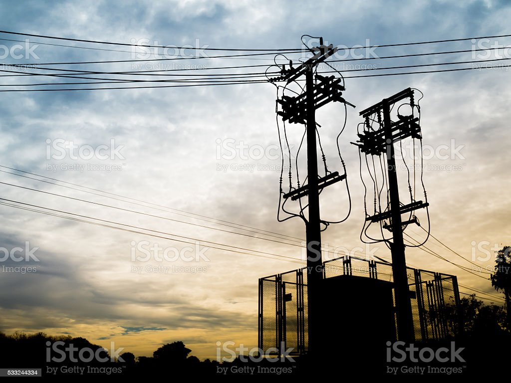 Silhouette Electricity Substation and High Voltage Pole stock photo
