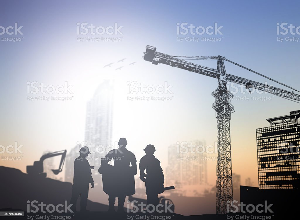 silhouette engineer  in a building site over Blurred constructio stock photo
