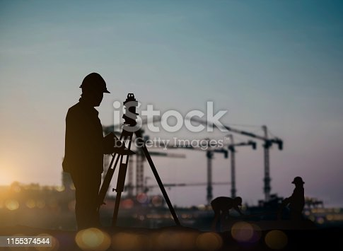 Silhouette of engineer and construction team working at site over blurred background for industry background with Light fair and bokeh. Create from multiple reference images together.