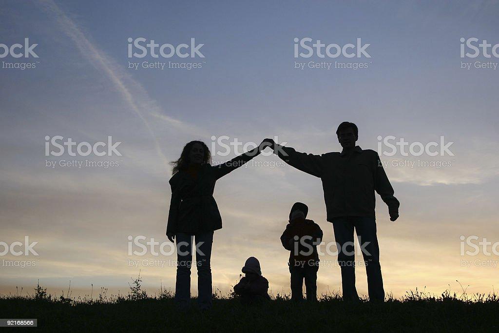 silhouette family house stock photo