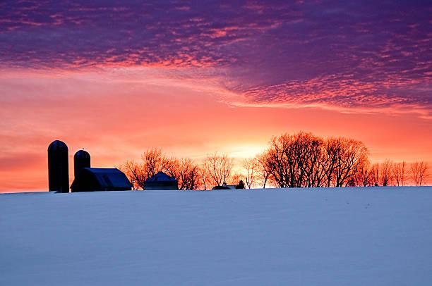 Silhouette farm sunset snow stock photo