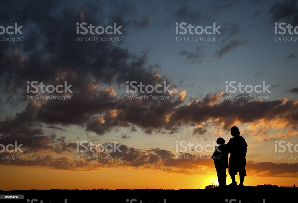 Silhouette figures with sunset royalty-free stock photo