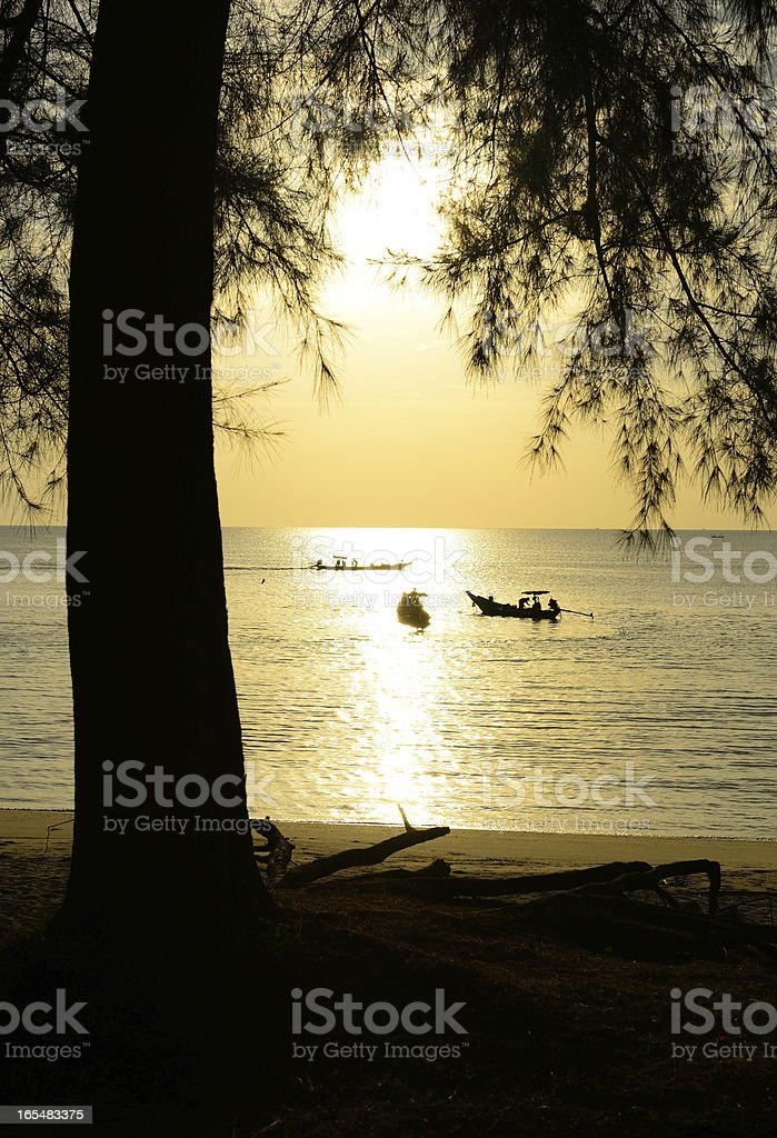 Silhouette fisherman are taking fishing boat royalty-free stock photo