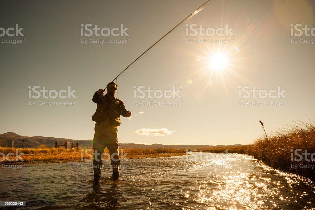 Silueta de los pescadores foto de stock libre de derechos