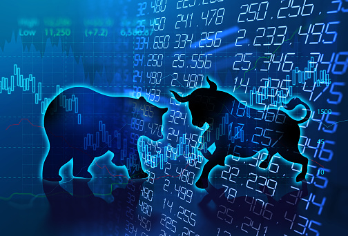 istock silhouette form of bull and bear on technical financial graph 915523904
