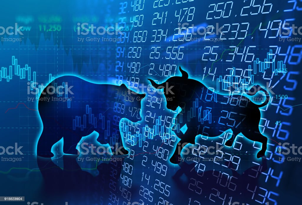 silhouette form of bull and bear on technical financial graph stock photo