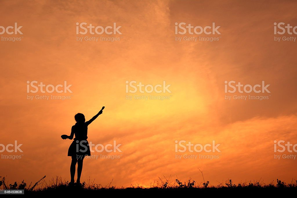 Silhouette girl holding paint brush stock photo