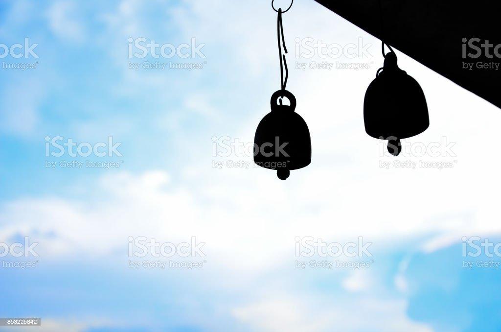 silhouette handbells and morning sky. stock photo