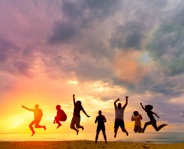 silhouette happy family people group celebrate jump for good life on weekend concept for win victory, person faith in financial freedom healthy wellness, great insurance team support retreat together in summer. - comemoração conceito imagens e fotografias de stock