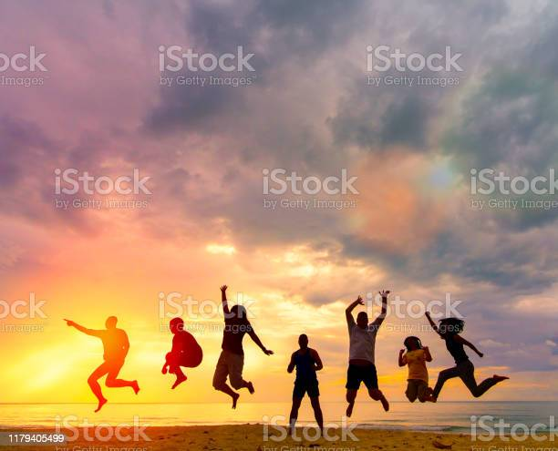 Photo of Silhouette Happy family people group celebrate jump for good life on weekend concept for win victory, person faith in financial freedom healthy wellness, Great insurance team support retreat together in summer.