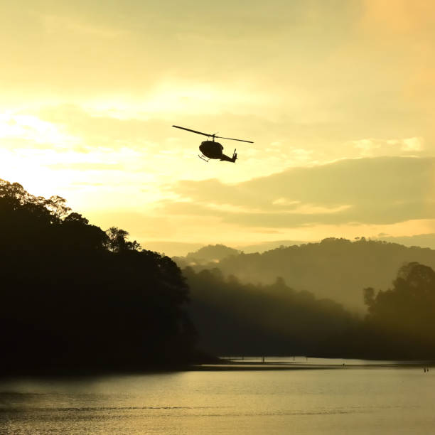 Silhouette helicopter and forest landscape, Thailand Silhouette helicopter and forest landscape at Bang Lang National Park, Thailand yala stock pictures, royalty-free photos & images