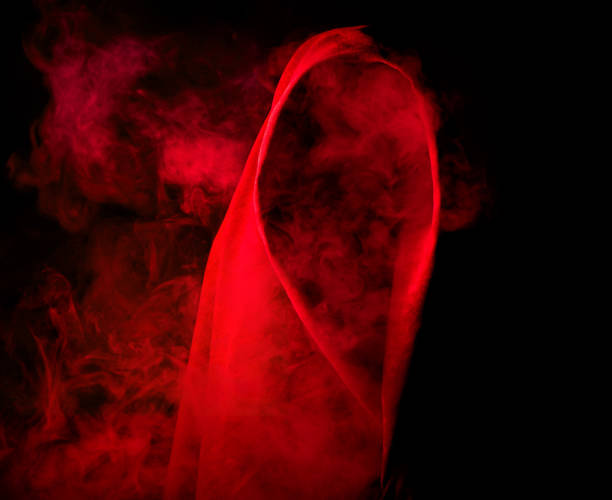silhouette hidden in red smoke stock photo