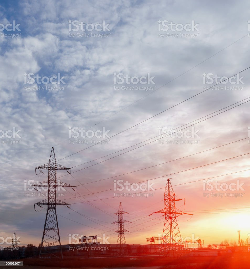 Silhouette High voltage electric tower on sunset time and sky on...