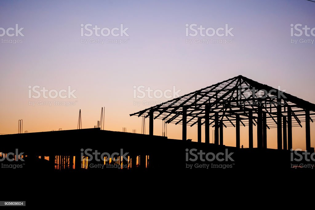 silhouette house building at construction site sunset background