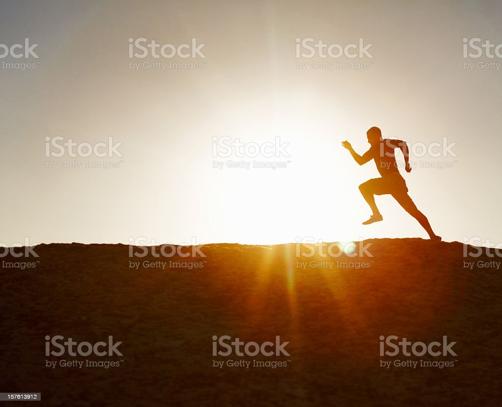 Silhouette image of an active runner against clear sky royalty-free stock photo