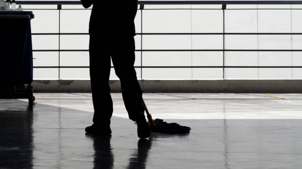 silhouette image of cleaning service people sweeping floor with mop - sweeping stock pictures, royalty-free photos & images