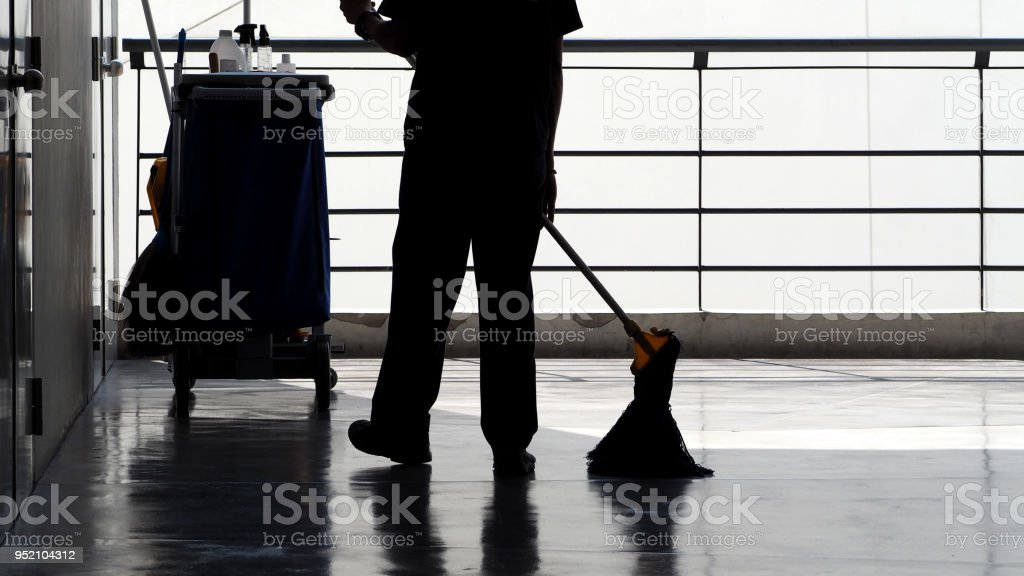 Silhouette Image Of Cleaning Service People Sweeping Floor