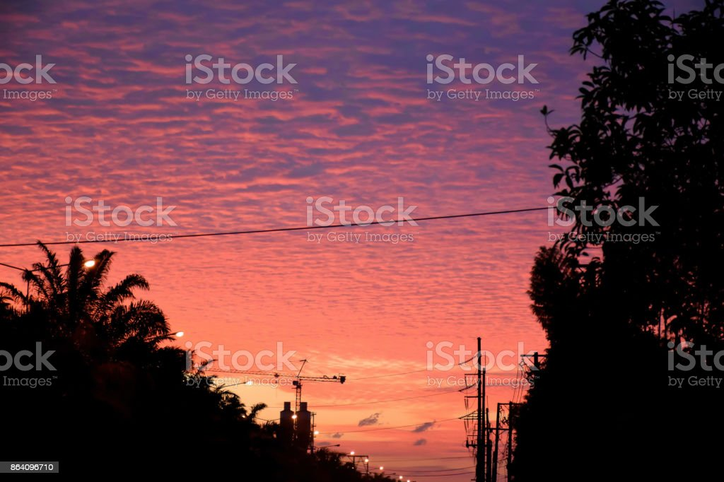 Silhouette image of country road to the big city in the evening and colorful sky background royalty-free stock photo
