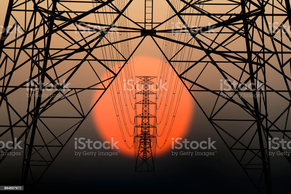 Silhouette image of High voltage tower stock photo