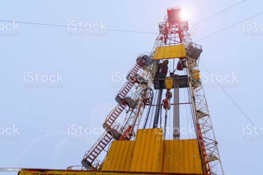 Silhouette Image Of Oil And Gas Drilling Rig In The Middle
