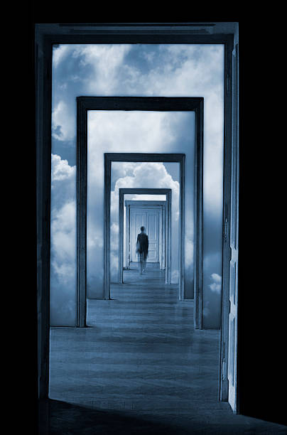 silhouette in a dreamlike corridor with many doors. - illusion stock photos and pictures