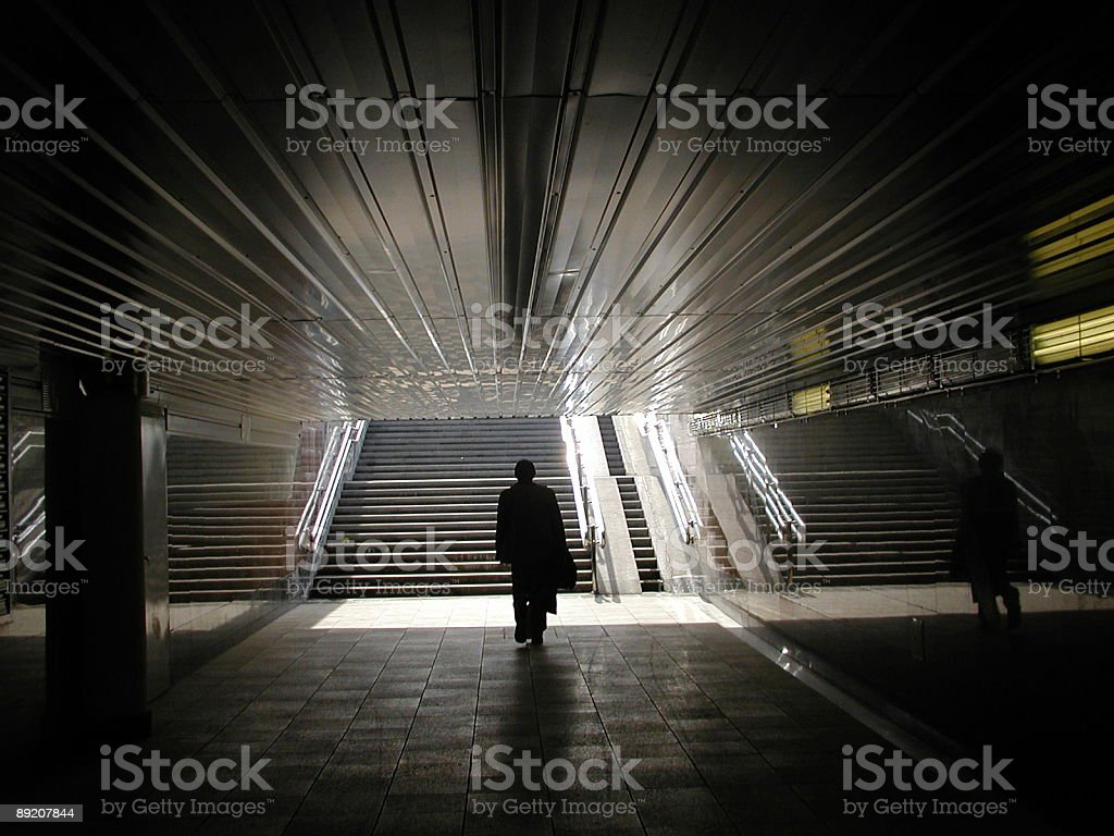 Silhouette in a tunnel stock photo