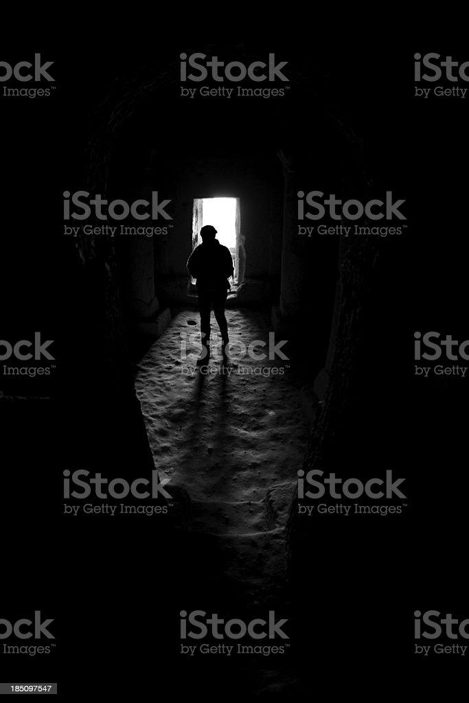 Silhouette in doorway of cave church, Goreme, Cappadocia stock photo