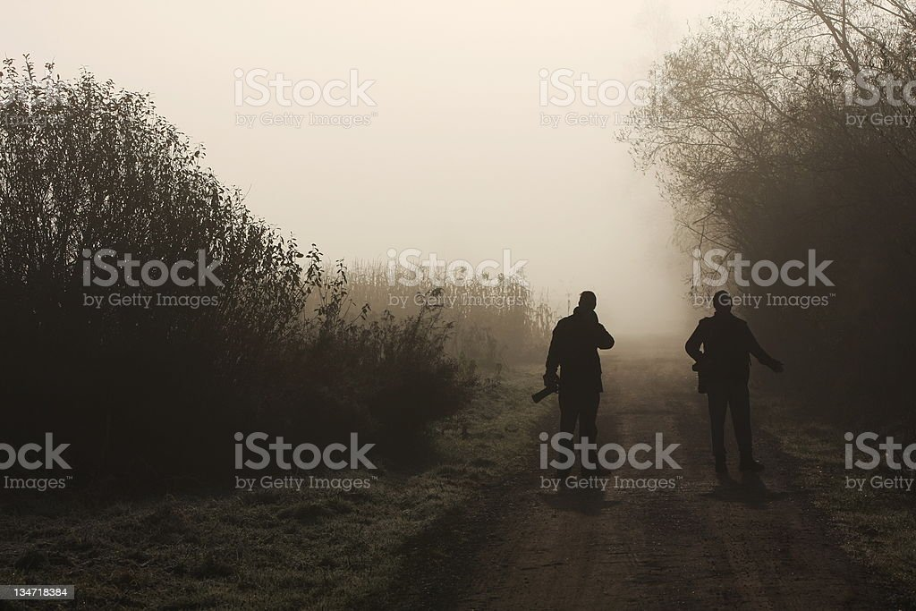 Silhouette in mist...Fellow photographers at work royalty-free stock photo
