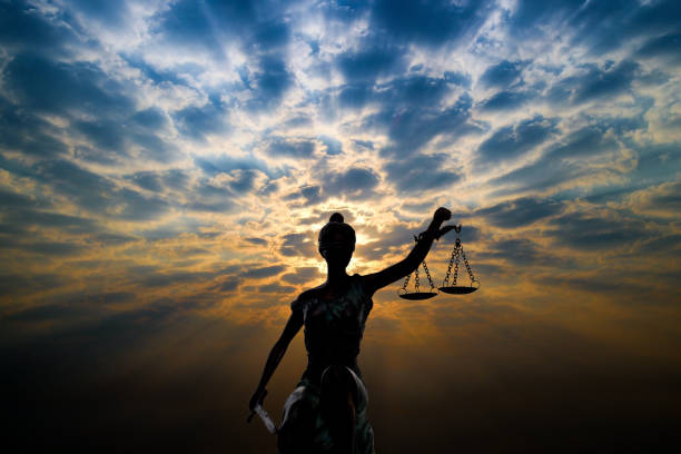 silhouette lady of justice and light of god - supreme court стоковые фото и изображения