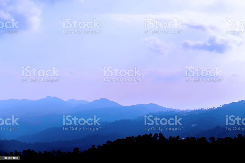 Silhouette, landscape mountains with fogs and hazy environment in winter stock photo