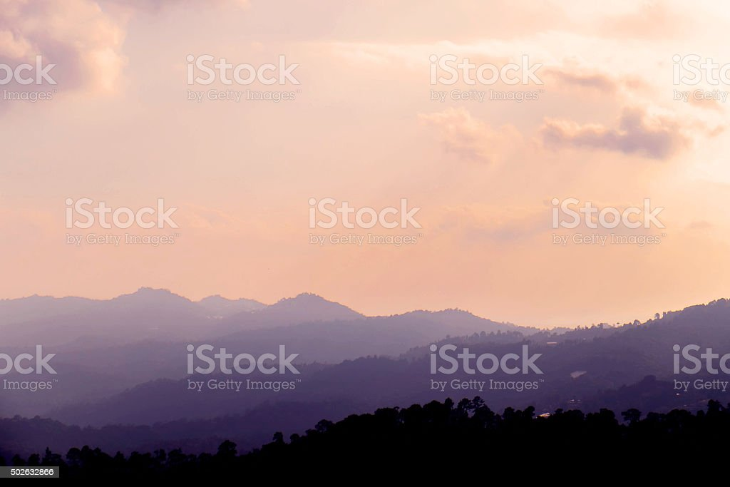 Silhouette, landscape mountains with fogs and hazy environment in summer stock photo