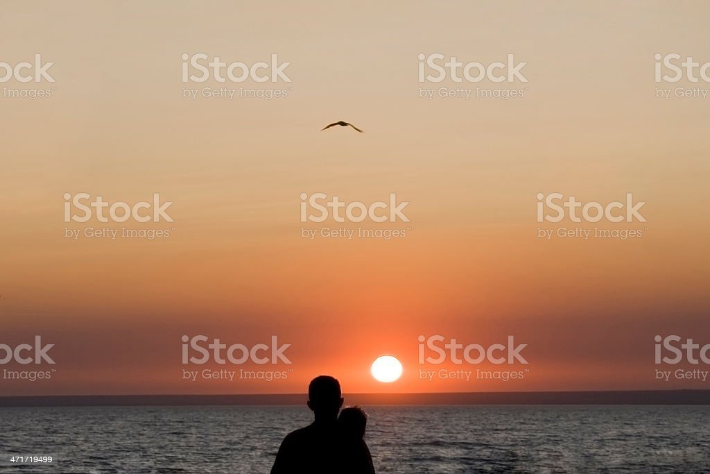 Silhouette man and woman again sunset royalty-free stock photo